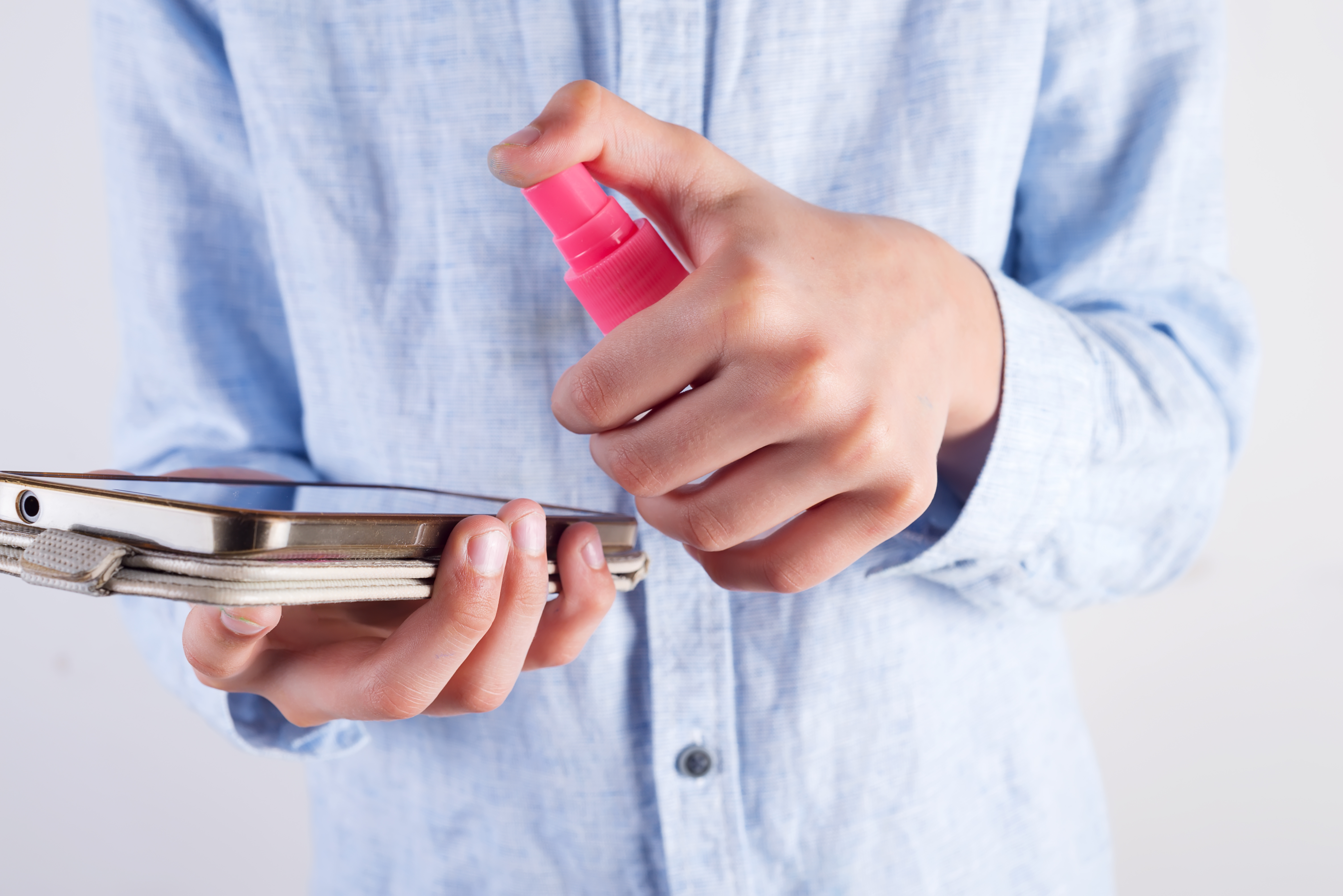 boy-in-a-pastel-blue-shirt-is-cleaning-his-phone-o-MKBRFEY