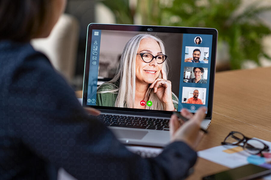 business-team-in-video-conference-5YKBLAD