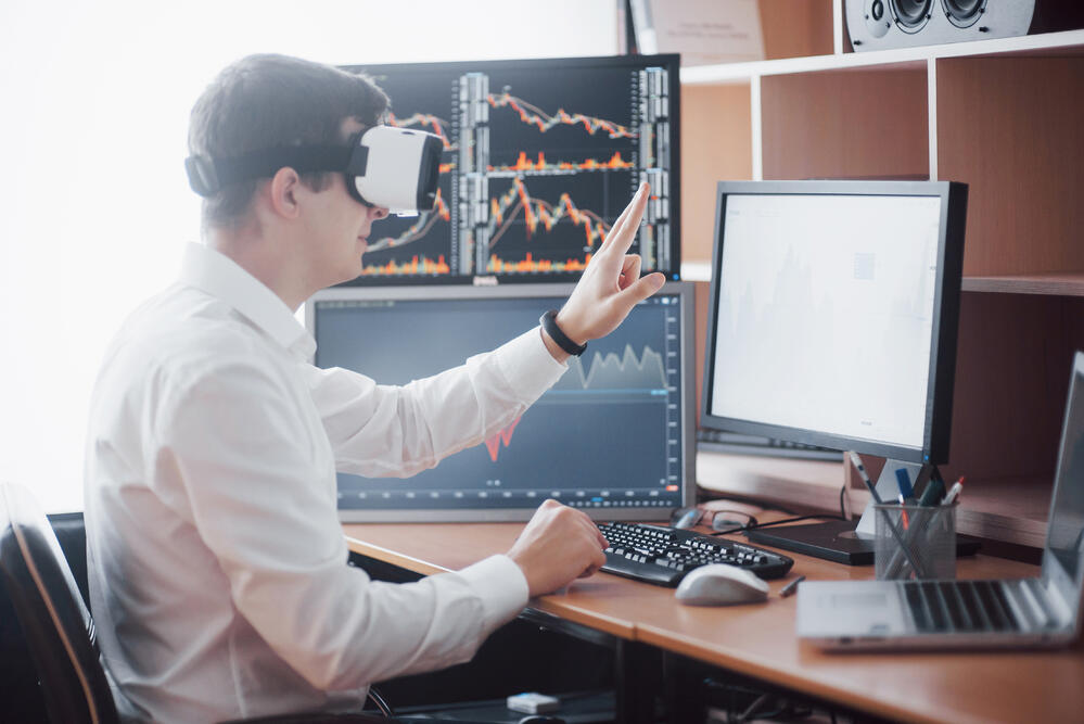 businessman-in-virtual-reality-trading-on-stock-ma-LT8BAQB