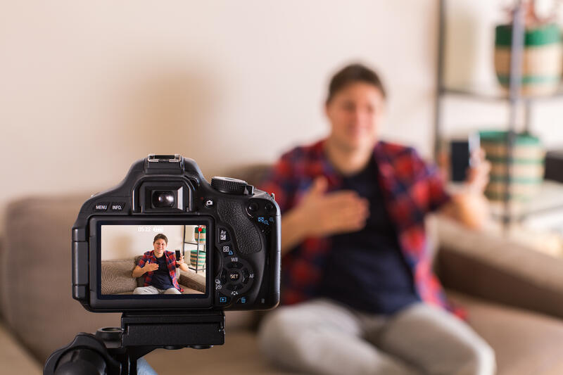vlogger-recording-social-media-video-while-sitting-A4NLQ3U